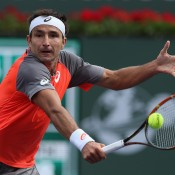 Marinko Matosevic of Australia returns a backhand volley to Bradley Klahn during the BNP Paribas Open at Indian Wells Tennis Garden on March 7, 2014 in Indian Wells, California.  (Photo by Jeff Gross/Getty Images)