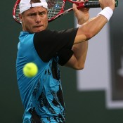 Lleyton Hewitt of Australia hits a return to Matthew Ebden of Australia during the BNP Paribas Open at Indian Wells Tennis Garden on March 6, 2014 in Indian Wells, California.  (Photo by Stephen Dunn/Getty Images)