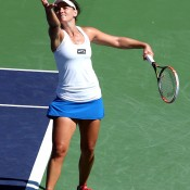 Casey Dellacqua of Australia serves to Simona Halep of Romania during the BNP Paribas Open at Indian Wells Tennis Garden on March 12, 2014 in Indian Wells, California. Halep won 6-2, 6-2.  (Photo by Stephen Dunn/Getty Images)