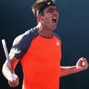 Marinko Matosevic celebrates his first round win over Alejandro Falla at the Sony Open in Miami; Getty Images