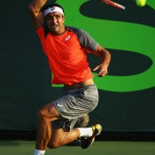 Marinko Matosevic of Australia returns a shot against Kei Nishikori of Japan during their match on day 5 of the Sony Open at Crandon Park Tennis Center on March 21, 2014 in Key Biscayne, Florida; Al Bello/Getty Images