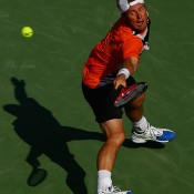 Lleyton Hewitt stretches for a backhand during his first round win over Robin Haase at the Sony Open in Miami; Getty Images