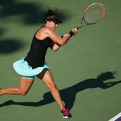 Casey Dellacqua in action during her three-set third round loss to 29th seed Venus Williams at the Sony Open in Miami; Getty Images
