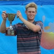 Luke Saville poses with the champion's trophy after winning the Mildura Grand Tennis International Pro Tour event; Jason Simmons