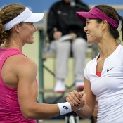 Li Na of China (R) and Samantha Stosur of Australia shake hands after a tennis exhibition match in Hong Kong on March 3, 2014. Stosur won 6-4, 6-4. (PHILIPPE LOPEZ/AFP/Getty Images)