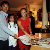 HONG KONG - MARCH 02:  Samantha Stosur of Australia signs a poster for guests during a Cocktail Reception at a hotel ahead of the BNP Paribas Tennis Showdown with Li Na of China at the Hong Kong Velodrome on March 2, 2014 in Hong Kong, Hong Kong.  (Photo by Stanley Chou/Getty Images)