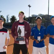 Jesse Delaney (L) and Jake Delaney (second from left) pose with their trophies after winning the boys' doubles final at the Gallipoli Youth Cup at Melbourne Park over Michael Commings (far rights) and Richard Yang; Elizabeth Xue-Bai