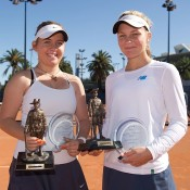 Anja Dokic (L) and Maddison Inglis pose with their trophies after winning the girls' doubles final at the Gallipoli Youth Cup at Melbourne Park; Elizabeth Xue-Bai