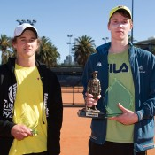 Jake Delaney (R) holds the trophy after winning the final of the Gallipoli Youth Cup at Melbourne Park over Cormac Clissold (L); Elizabeth Xue-Bai