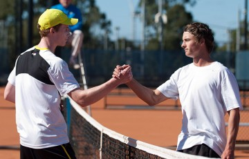 Jake Delaney (L) shakes hands with Cormac Clissold after winning the final of the Gallipoli Youth Cup at Melbourne Park; Elizabeth Xue-Bai