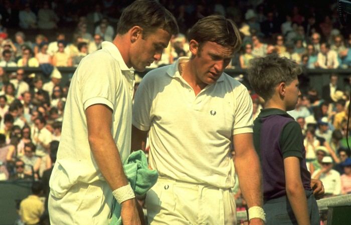 John Newcombe (left) and Tony Roche of Australia discuss tactics during a break in a doubles match at the Wimbledon Championships; Getty Images
