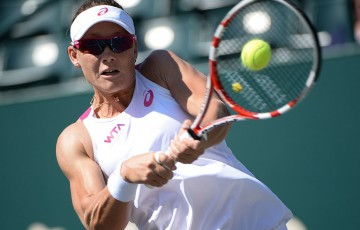 Sam Stosur plays a backhand during her second round victory over Yaroslava Shvedova at the 2014 Family Circle Cup in Charleston; Chris Smith/Family Circle Cup