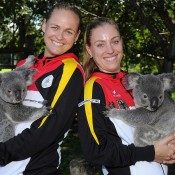 BRISBANE, AUSTRALIA - APRIL 18:  Anna-Lena Groenefeld and Angelique Kerber (R) of Germany hold koalas during the official draw ahead of the Fed Cup Semi Final tie between Australia and Germany at Lone Pine Koala Sanctuary on April 18, 2014 in Brisbane, Australia.  (Photo by Matt Roberts/Getty Images)