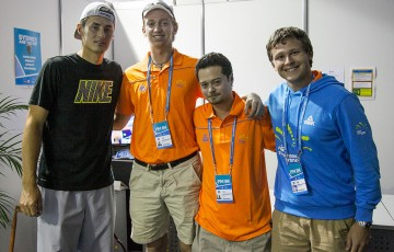 Apia International Sydney 2014 finalist Bernard Tomic poses with tournament volunteers.