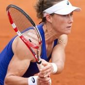 Sam Stosur in action against Monica Puig in her first round victory at Roland Garros; Elizabeth Xue Bai