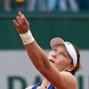Sam Stosur in action against Monica Puig in her first round victory at Roland Garros; Elizabeth Xue Bai