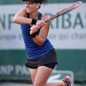 Casey Dellacqua in action during her first round victory over Lourdes Dominguez Lino at Roland Garros; Getty Images