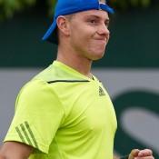 James Duckworth in action against Leonardo Mayer in the first round at Roland Garros; Elizabeth Xue Bai