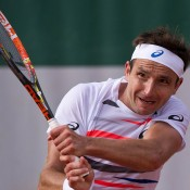 Marinko Matosevic in action during his first round victory over Dustin Brown at Roland Garros; Elizabeth Xue Bai