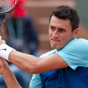 Bernard Tomic in action against 12th seed Richard Gasquet on Court Suzanne Lenglen in the first round at Roland Garros; Elizabeth Xue Bai