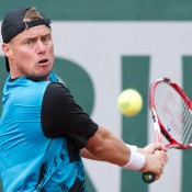 Lleyton Hewitt in action against Carlos Berlocq in the first round at Roland Garros; Elizabeth Xue Bai
