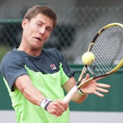 Matt Ebden in action against Pablo Cuervas in the first round at Roland Garros; Elizabeth Xue Bai