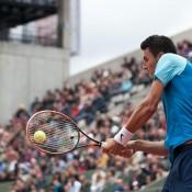 Bernard Tomic in action against 12th seed Richard Gasquet on Court Suzanne Lenglen in the first round at Roland Garros; Elizabeth Xue Bai
