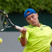 James Duckworth in action against Leonardo Mayer in the first round at Roland Garros; Elizabeth Xue Bai