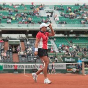 Ash Barty in action against 20th seed Alize Cornet on Court Philippe Chatrier in the first round at Roland Garros; Elizabeth Xue Bai
