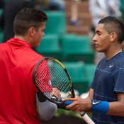 Nick Kyrgios (L) shakes hands with No.8 seed Milos Raonic after falling in the first round at Roland Garros; Elizabeth Xue Bai