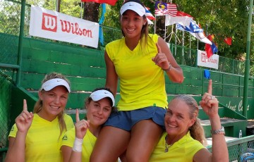 Australia's Junior Fed Cup team of (L-R) Maddison Inglis, Kimberly Birrell, Priscilla Hon and captain Louise Pleming celebrate Hon's 16th birthday in style with victory at the Asia/Oceania qualifying event in Kuching, Malaysia; Tennis Australia