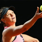 Casey Dellacqua in action during her second round loss to Li Na at the Internazionali BNL d'Italia in Rome; Getty Images