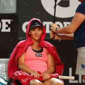 Casey Dellacqua takes time out during a storm in her second round loss to Li Na at the Internazionali BNL d'Italia in Rome; Getty Images