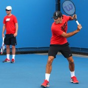 Roger Federer practices while Stefan Edberg (left) and Severin Luthi watch from the sidelines, Australian Open, Melbourne, 2014. GETTY IMAGES