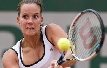 Jarmila Gajdosova plays a backhand during her win over Chanel Simmonds of South Africa in the first round of Roland Garros qualifying; Elizabeth Xue Bai