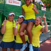 The winning Australian junior Fed Cup team of (L-R) Maddison Inglis, Kimberly Birrell, Priscilla Hon and captain Louise Pleming celebrate their progression to September's final on Hon's 16th birthday; Tennis Australia