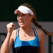Olivia Rogowska celebrates during her second round qualifying victory at Roland Garros; Elizabeth Xue Bai