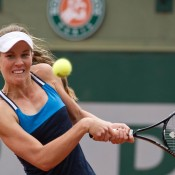 Olivia Rogowska in action during her first round qualifying victory at Roland Garros; Elizabeth Xue Bai