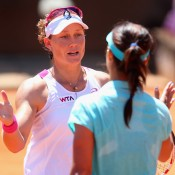 Sam Stosur shakes hands with Li Na after her third round loss at the Internazionali BNL d'Italia in Rome; Getty Images