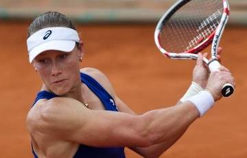 Sam Stosur in action during her second round victory over Yvonne Meusberger at Roland Garros; Elizabeth Xue Bai