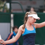 Olivia Rogowska in action during her final round qualifying loss at Roland Garros to Sofia Shapatava; Elizabeth Xue Bai
