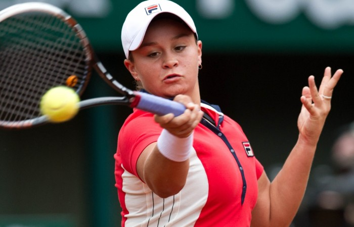 Ash Barty plays a forehand during her first round loss to Alize Cornet of France on Court Philippe Chatrier at Roland Garros; Elizabeth Xue Bai