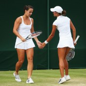 Jarmila Gajdosova (L) and Arina Rodionova in action during the women's doubles; Getty Images