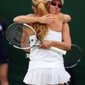 Anastasia Rodionova (R) embraces Alla Kudryavtseva of Russia after winning their first round match against Yanina Wickmayer and Shuai Zhang; Getty Images