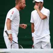 Paul Hanley (R) consults with Czech partner Lukas Dlouhy in the men's doubles event; Getty Images