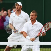 Chris Guccione (L) and Lleyton Hewitt in action in the men's doubles event; Getty Images