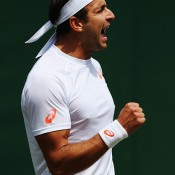Marinko Matosevic celebrates a point during his fuve-set second round loss to Jeremy Chardy; Getty Images