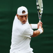 James Duckworth plays a backhand during his five-set first round loss to 13th seed Richard Gasquet; Getty Images