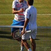 Marinko Matosevic (L) shakes hands with top seed Stan Wawrinka after falling in the quarterfinals of the ATP Queen's Club event in London, England; Getty Images