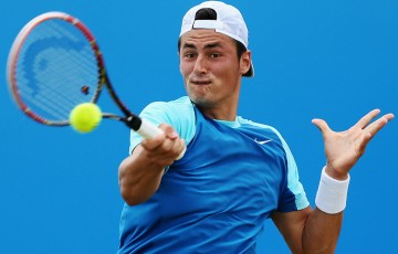 Bernard Tomic in action during a second round loss to Radek Stepanek at the ATP Queen's Club event in London; Getty Images